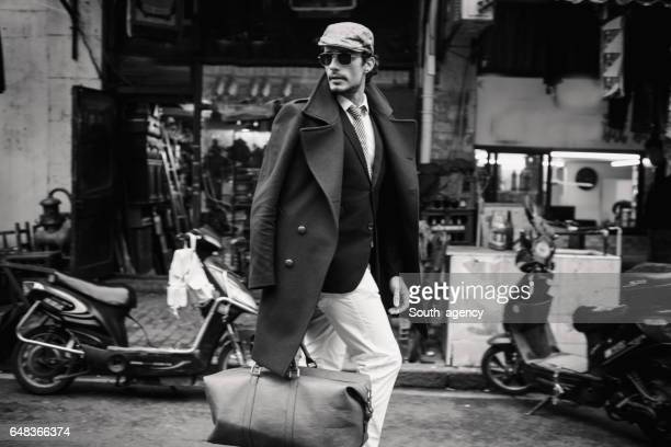 handsome traveler - moda stock photos and pictures
