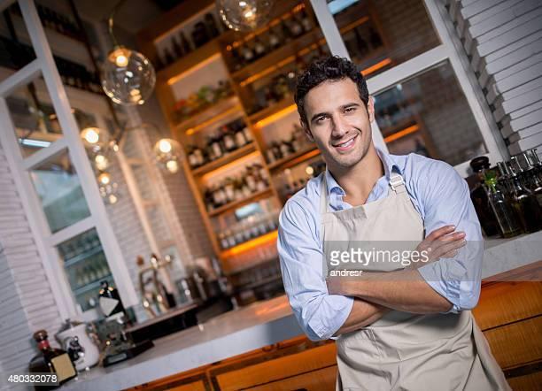 Handsome waiter working at a restaurant
