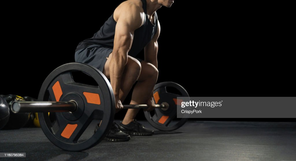 Handsome weightlifter preparing for training. Training with barbell, Athletic shirtless young sports man. Fitness model with barbell in gym : Stock Photo