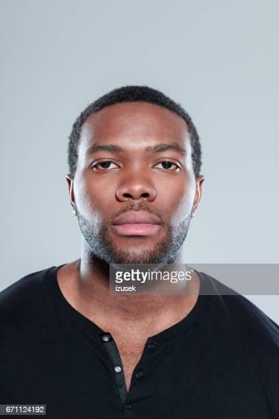 ハンサムな若いアフロ ・ アメリカ人顔 - 指名手配写真 ストックフォトと画像