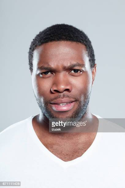 Handsome young afro american man staring at camera
