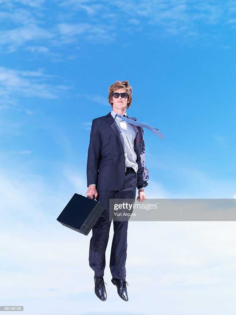 Handsome Young Business Man Floating In Air Stock Photo