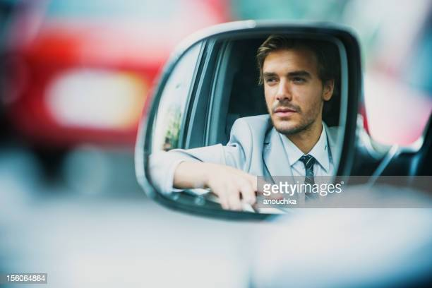 Handsome Young Businessman Driving Car
