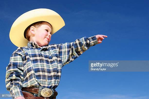 Hübscher junge Cowboy