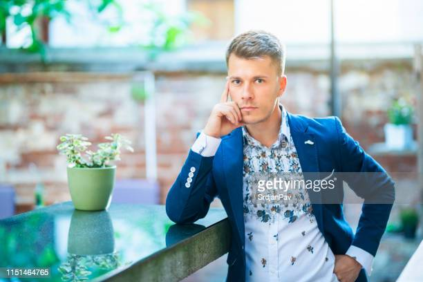 handsome young gentlemen with impeccable style - multi colored suit stock pictures, royalty-free photos & images