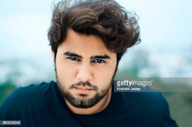 Handsome Young Indian Adult With An Intense Look
