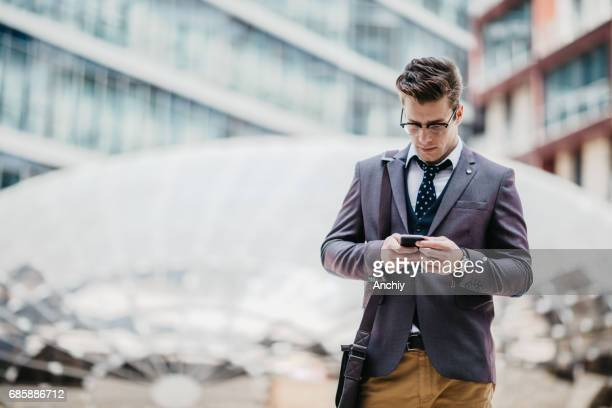 Handsome young lawyer using a smartphone