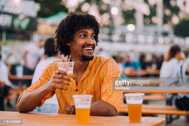 handsome young man drinking beer - drinking stock pictures, royalty-free photos & images