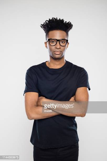 handsome young man in black casuals - one man only stock pictures, royalty-free photos & images