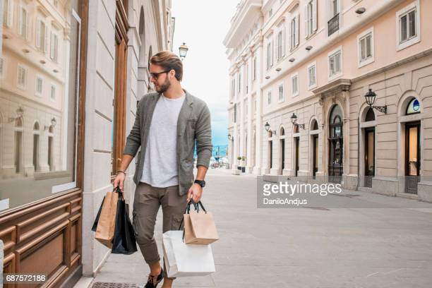 handsome young man in shopping
