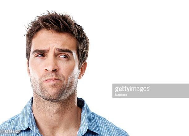 handsome young man in striped shirt with a frown - confused stock pictures, royalty-free photos & images