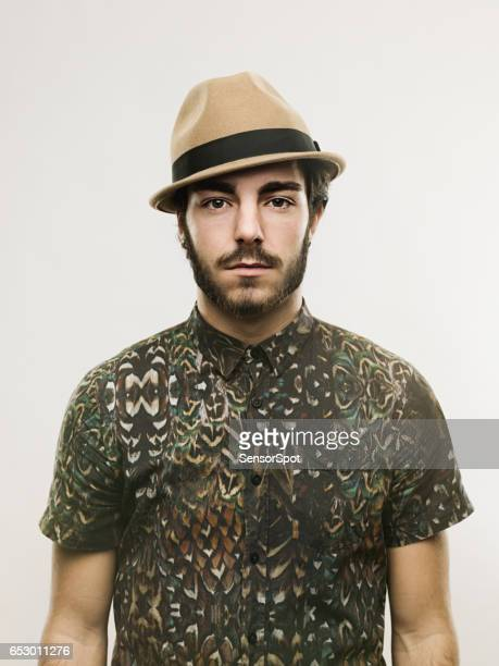 Handsome young man in stylish shirt and hat
