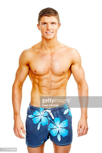 Handsome young man in swim shorts