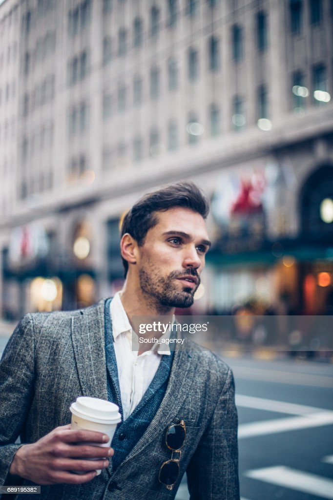Handsome young man on a coffee brake : Stock Photo