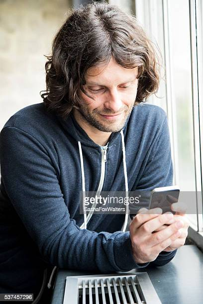 Handsome young man using cell phone