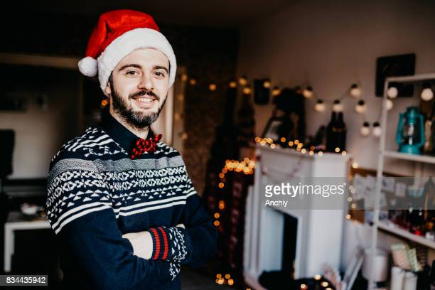 Handsome Young Man wearing Santa's Hat. Christmas Guy Portrait. Smilin at camera