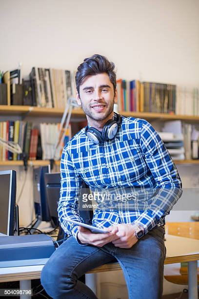 Handsome young man with digital tablet at startup
