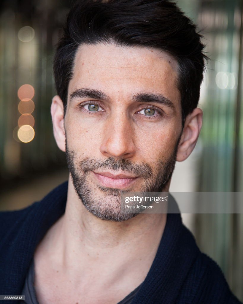 Handsome Young Man With Green Eyes And Dark Hair High-Res ...