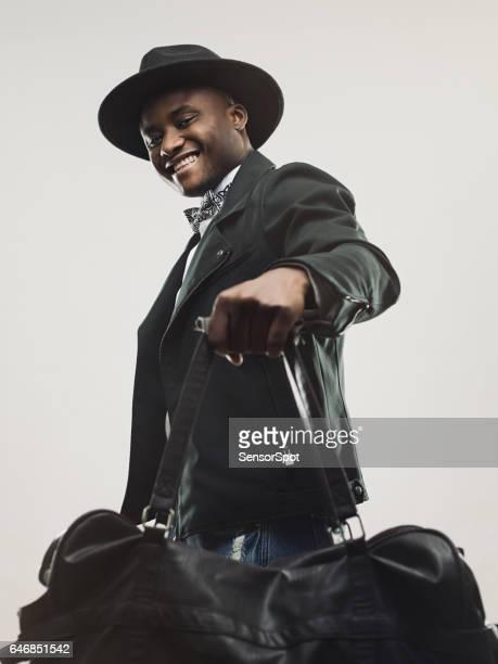 Handsome young man with handbag