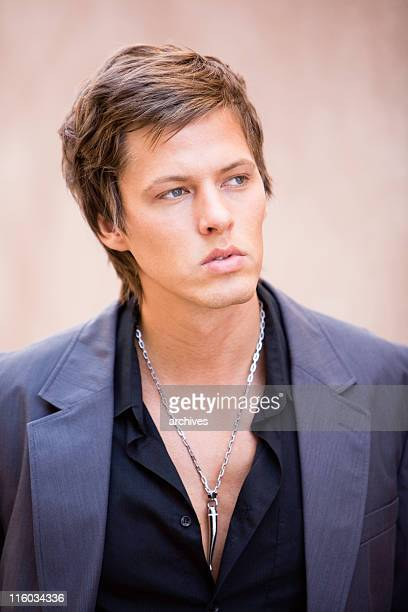 handsome young man with jewelery - big lips stock photos and pictures