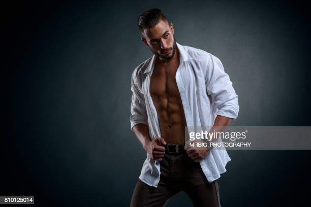 handsome young men - handsome muscle men stock photos and pictures