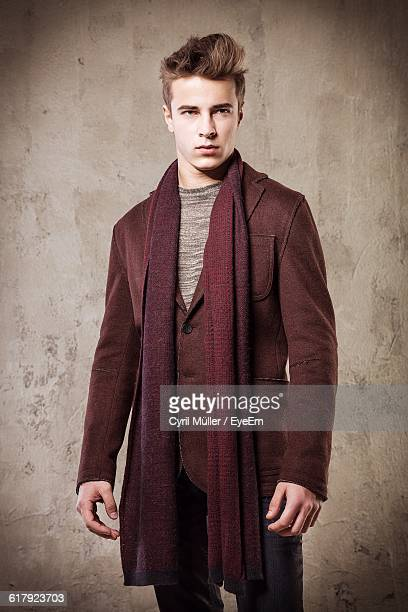 Handsome Young Model Standing Against Wall