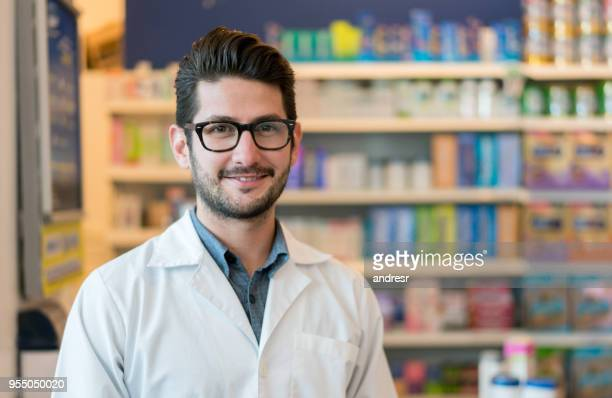 Handsome young pharmacist looking with confidence at the camera