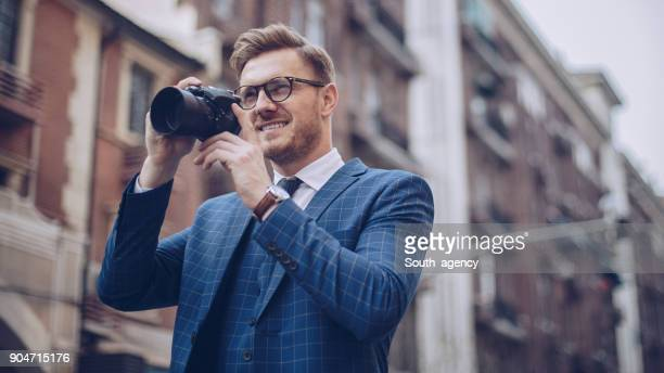 handsome young photographer - south_agency stock pictures, royalty-free photos & images