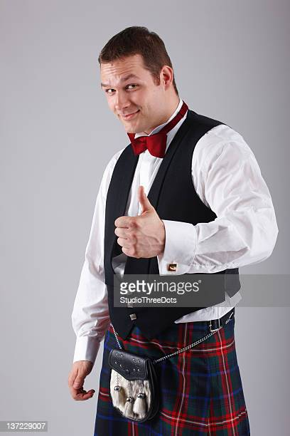 handsome young scotsman - tartan stock pictures, royalty-free photos & images