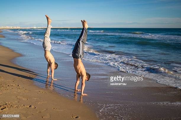 Handstand hold street workout at the beach