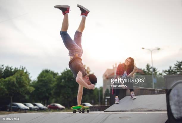 Handstand on skateboard