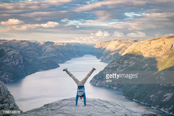 handstand, pulpit rock preikestolen, norway - extreme sports stock pictures, royalty-free photos & images