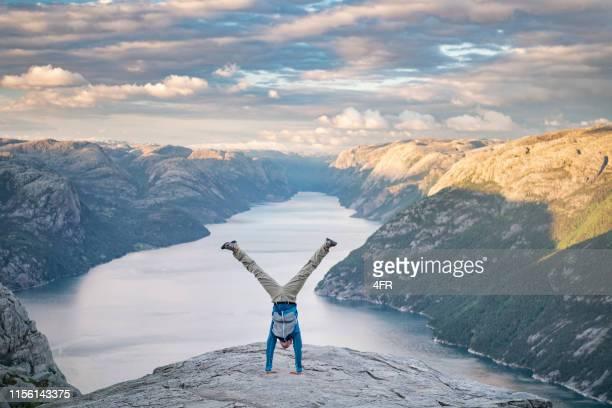 handstand, pulpit rock preikestolen, norway - legs apart stock pictures, royalty-free photos & images