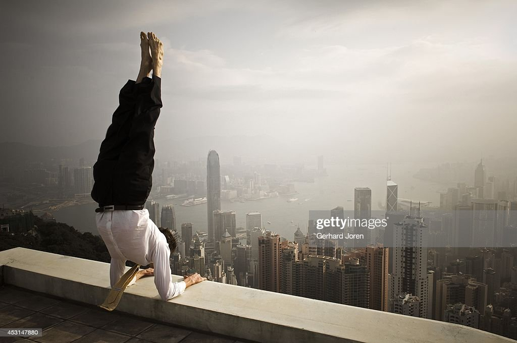 A handstand yoga pose on the rooftop.