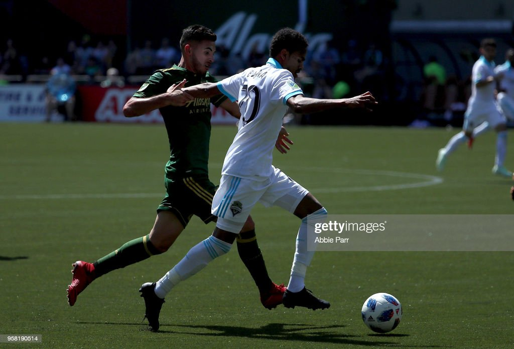 Handwalla Bwana #70 of the Seattle Sounders dribbles against Liam Ridgewell #24 the of Portland Timbers in the seocond half during their game at Providence Park on May 13, 2018 in Portland, Oregon.