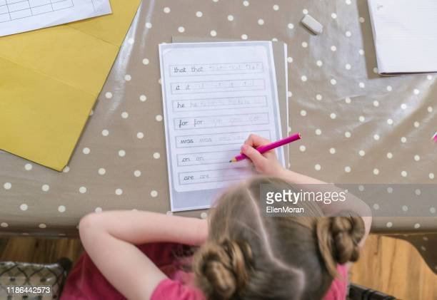 handwriting homework - writing stock pictures, royalty-free photos & images