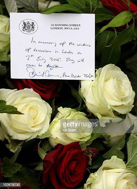 A handwritten card from British Prime Minister David Cameron is attached to a bouquet of flowers placed at the memorial to the victims of the July 7...