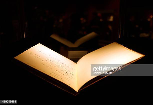 A handwritten manuscript belonging to British mathematician and code breaker Alan Turing is displayed during a press preview in New York on April 9...