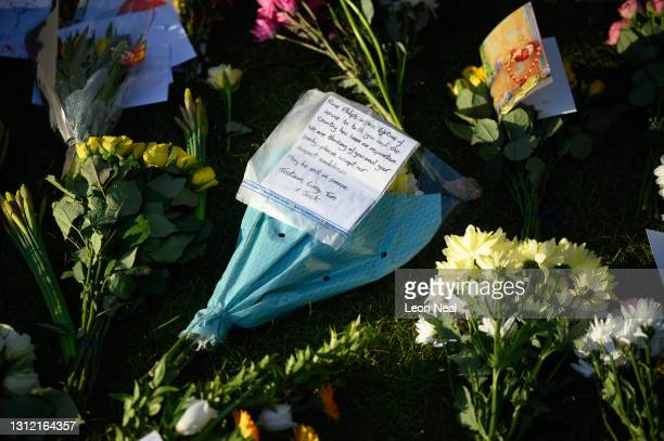 Hand-written messages for the queen are seen among the flowers, as tributes continue to be made to Prince Philip, the Duke Of Edinburgh who died at...