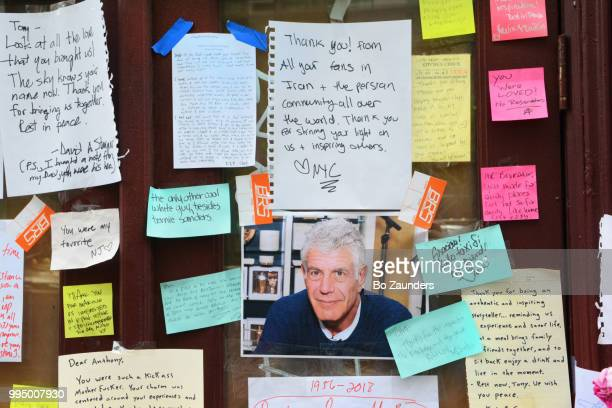 Hand-written notes and photographs left in memory of Anthony Bourdain, and displayed at the closed location of Brasserie Les Halles in NYC, where Bourdain once worked as an executive chef.