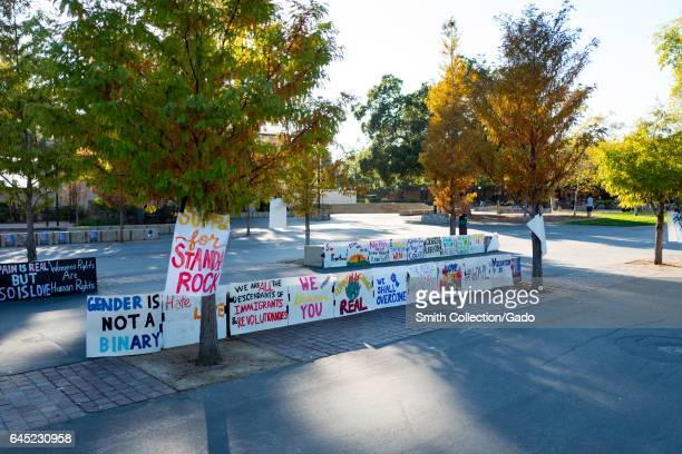 Handwritten protest posters for various causes including Black Live Matter LGBT rights Standing Rock and womens' rights on a quad at Stanford...