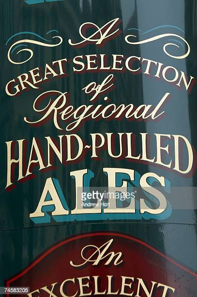 Handwritten traditional pub sign on window, close-up
