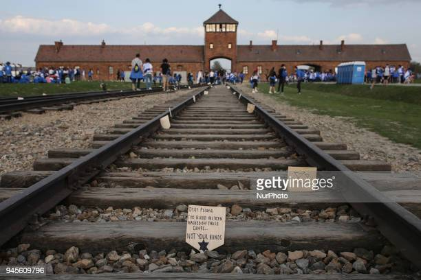 A handwritten wooden sign during the 'March of the Living' at the former NaziGerman Auschwitz Birkenau II concentration and extermination camp at...