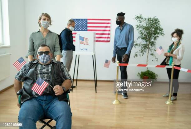 handycapped man after voting on election day - presidential candidate stock pictures, royalty-free photos & images