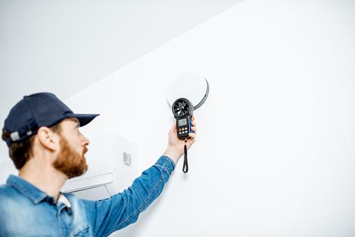 Handyman checking of air ventilation 1138823692