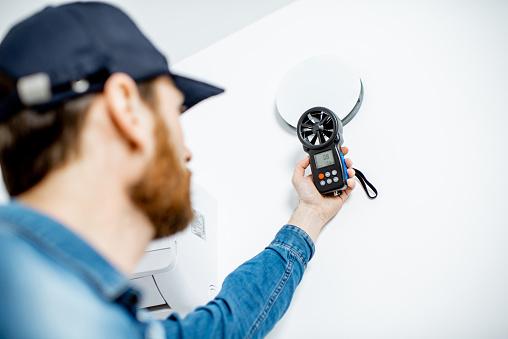 Handyman checking of air ventilation 1138823699
