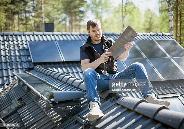 handyman constructing his own home - roof stock pictures, royalty-free photos & images
