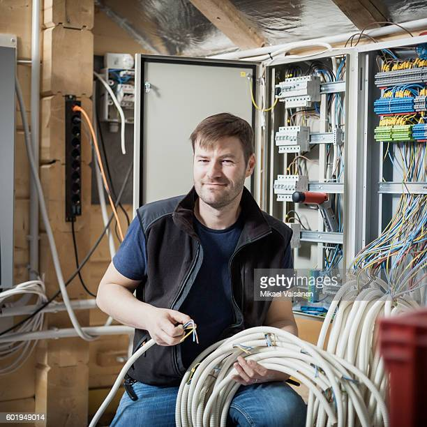 Handyman constructing his own home