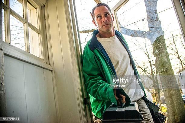 Handyman entering house