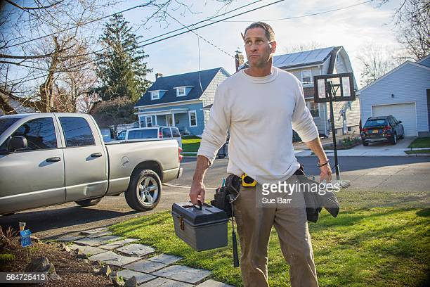 handyman going to house call - craftsman stock photos and pictures
